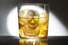 Glass of whiskey with a caravel Royalty Free Stock Photos