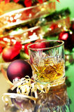 Christmas time and glass of whiskey Stock Photo