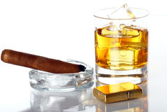 Glass of Whiskey and Cigar. Against white background Royalty Free Stock Photos
