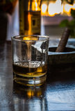 Glass of whiskey and cigar Royalty Free Stock Photography