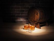 Glass of whiskey , Cigar and old oak barrel.  royalty free stock photos