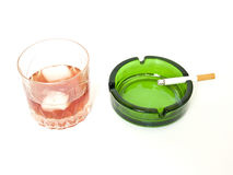 Glass of whiskey, cigarettes and ashtray Royalty Free Stock Image