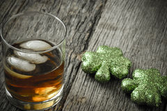 Glass of Whiskey and Clovers Royalty Free Stock Photos