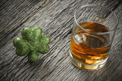 Glass of Whiskey and Clovers Stock Image