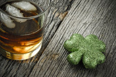 Glass of Whiskey and Clovers Stock Images