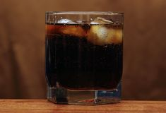 Glass of whiskey. And cola with ice royalty free stock photography