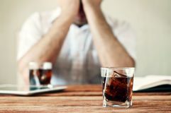 Glass of whiskey with cola on a wooden table Stock Images