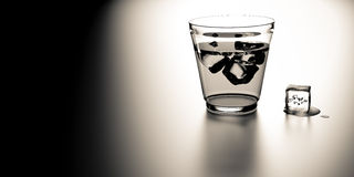 Glass of whiskey with cube of ice Royalty Free Stock Photo