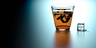 Glass of whiskey with cube of ice Royalty Free Stock Images