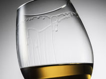 Glass of whiskey. Detail of glass of whiskeys on Gray Background Royalty Free Stock Images