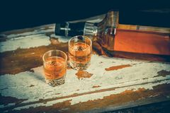 A glass of whiskey and a double whiskey, a bottle of whiskey Royalty Free Stock Photo