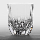 Glass for whiskey. Empty glass for whiskey on gray background Stock Photos