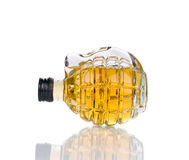 Glass of whiskey with grenade. Royalty Free Stock Images