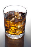Glass of  whiskey and ice Stock Images