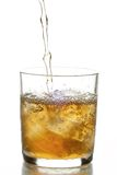 Glass with whiskey and ice Royalty Free Stock Image