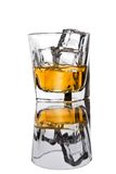 Glass of whiskey with ice Stock Photography