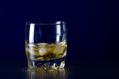 Glass of whiskey and ice Stock Photos