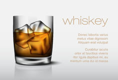 Glass of whiskey with ice Stock Image