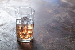 Glass of whiskey with ice on black background. Glass of whiskey with ice on black background Stock Image