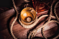 Glass of whiskey with ice, a bottle of single malt whiskeys Royalty Free Stock Images