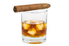 Glass of whiskey with ice and cigar Stock Photos