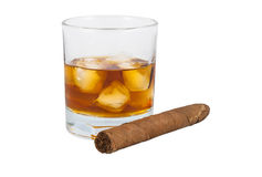 Glass of whiskey with ice and cigar Royalty Free Stock Images