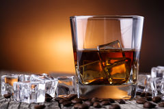 Glass of whiskey with ice and coffee beans. Stock Image