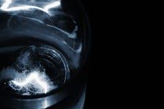 Glass of whiskey & ice cube, sadness Stock Photo