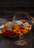 Glass of whiskey with ice cubes Stock Photo