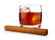 Glass of whiskey with ice cubes and havana cigar Stock Photos