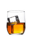 Glass of whiskey with ice cubes isolated on white royalty free stock image