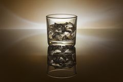 A glass of whiskey ice a dark rum glass background Royalty Free Stock Image