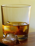 Glass of whiskey with ice Royalty Free Stock Images