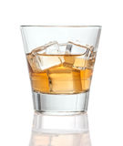 Glass of whiskey with ice, isolated royalty free stock image
