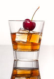 Glass of whiskey with ice, isolated on white background Royalty Free Stock Photos