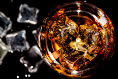Glass of whiskey with ice Royalty Free Stock Photography