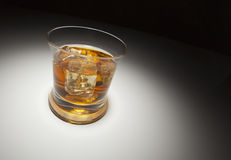 Glass of Whiskey and Ice Under Spot Light Stock Photography