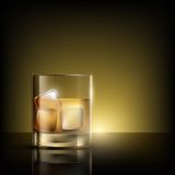 Glass of whiskey with ice Royalty Free Stock Photo