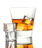 Glass of whiskey with ice,  on white background Royalty Free Stock Photo