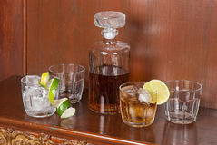 Glass with whiskey and ice on a wood table Stock Photo
