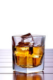 A glass of whiskey with ice on a wooden bar Stock Photos