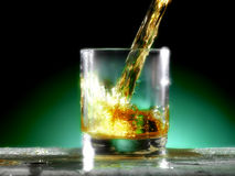Glass of whiskey. Whiskey poured into the glass Stock Photo