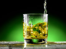 Glass of whiskey. Whiskey poured into the glass Royalty Free Stock Image