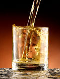 Glass of whiskey. Whiskey poured into the glass Stock Image