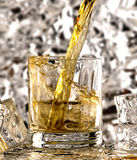 Glass of whiskey. Whiskey poured into the glass Stock Photography