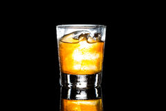 A glass of whiskey on the rock against a dark background Royalty Free Stock Photos