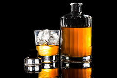 A glass of whiskey on the rock against a dark background Stock Images