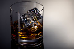 A glass of whiskey on the rocks Stock Images
