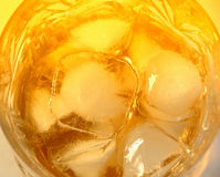 Glass of whiskey with rocks. Close-up of a glass of whiskey with rocks Stock Photo