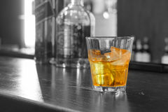 Glass of whiskey on the rocks Royalty Free Stock Image